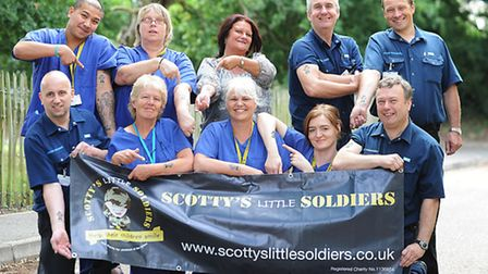 Sporting their Scotty's Little Soldiers tattoos on Scotty's Day are QEH NHS workers, back row (from