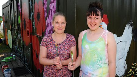 Thetford Academy students Sarah Adams (left) and Cally Murgatroyd who are painting the storage area
