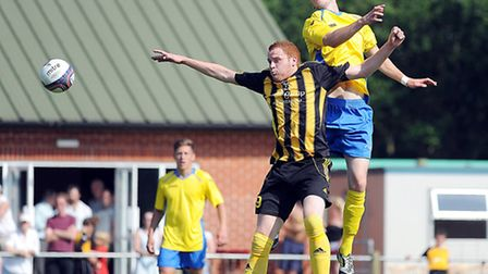 Kyle Plumb, front, impressed during Fakenham's 2-1 loss to King's Lynn. James Page found the net for