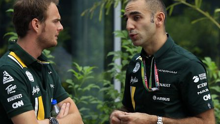 Caterham team principal Cyril Abiteboul (right) catches up with Giedo van der Garde. Photo: Charles