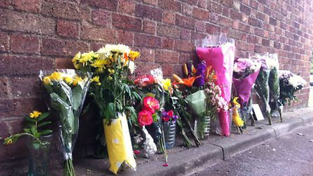 Flowers where Tom Richardson died after flat fire in Holls Lane, Norwich