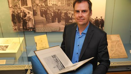 Senior archivist Jonathan Draper sets up The Watling Way: City of Opportunity exhibition at the Norf