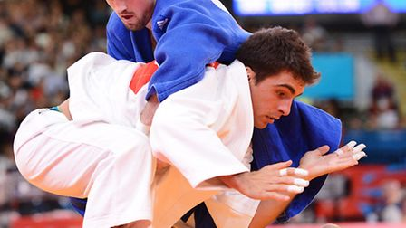 Olympic Judo action 2012 Elimination Round 32 Colin Oates (blue) V Ivo Dos Santos. Photo: Nick But