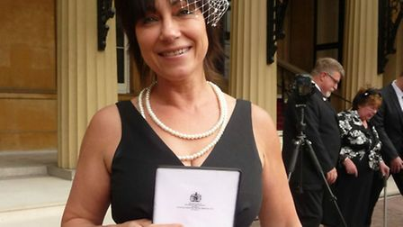 Debbie Chedgey with the MBE she was awarded tody for her work the Matrix Project giving help, comfo
