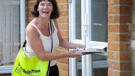 County Council Chairman Hilary Cox delivering papers after her husband, William, suffered a heart at
