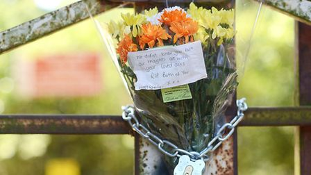 Flowers have been placed onto the gates of Bawsey Pits. Picture: Ian Burt