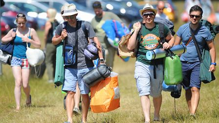 Latitude 2013 at Henham Park in Suffolk.People arriving in the sunshine to set up camp on the first