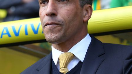 Norwich City boss Chris Hughton confirmed he dealyed his arrival in the USA to step up the club's pursuit of fresh signings.