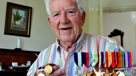 Arthur Towlson with his array of medals. From left: the Malta 50th anniversary, Russian convoy comme