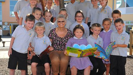 Doreen Thurlow who is retiring after 35 years in teaching. Pictured with pupils at Mile Cross Primar