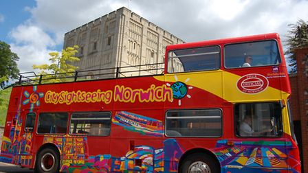 The City Sightseeing bus passes by Norwich Castle.