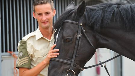 Lance Corporal of Horse, Tim Baker from Caistor-St-Edmund near Norwich at the Household Cavalry Mounted Regiments...