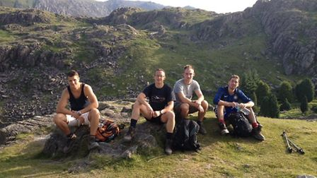 Oliver Denton, Marlon Fulcher, Terry West and Tom Brown after completing the UK three peaks challeng