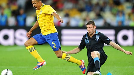 Martin Olsson skips past James Milner during Sweden's Euro 2012 clash with England.