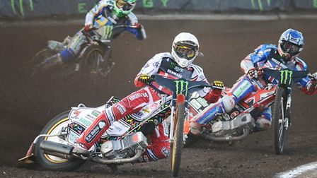 Niels-Kristian Iversen leads Chris Harris in heat one of the 2013 Speedway World Cup at the Norfolk