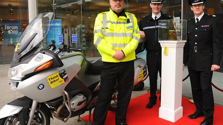Assistant Chief Constable Charlie Hall, centre; area manager for the Fire Service, Stuart Horth, rig