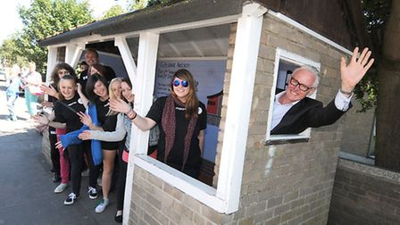 Norman Lamb MP takes a look at one of the refurbished bus shelters in North Walsham which was done b
