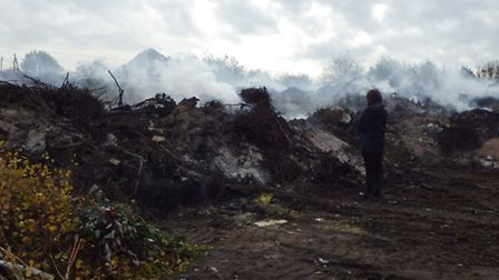 A man who stored and burned waste at a bonfire party on an illegal site near to the Norfolk-to-Londo