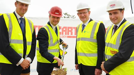 Waveney MP Peter Aldous with the shovel as work starts on the multi-million pound Essex and Suffolk