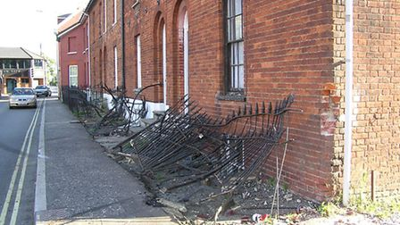 A car crashed into metal railings in front of houses on Commercial Road in Dereham, in the early hou
