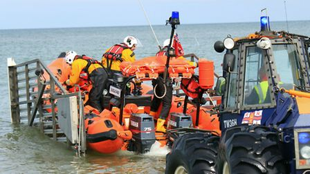 RNLI volunteers from the Atlantic lifeboat returning to Happisburgh.