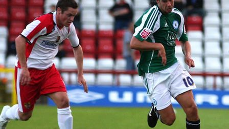 Gary Mills, in action for Stevenage against Peterborough during the 2008/09 term, chases George Boyd