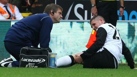 Norwich City's new signing Gary Hooper was forced to depart on a stretcher after damaging his left l