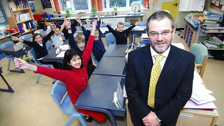 Pupils and staff at Catton Grove Primary School celebrating after a good Ofsted report in 2009. Head
