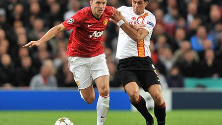 Johan Elmander in action for Galatasaray during last season's Champions League, tussling with Manche