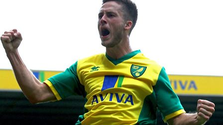 Ricky van Wolfswinkel salvaged a Premier League point for Norwich City in Saturday's 2-2 opening day