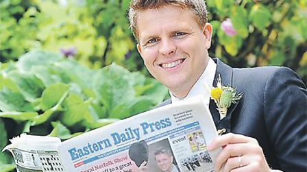 2013 Royal Norfolk Show President Jake Humphrey reads his copy of theEastern Daily Press.