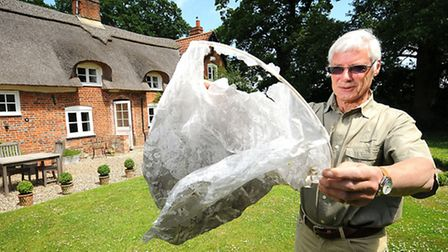 William Grant with the remains of the scorched Chinese lantern which landed inches from his thatched