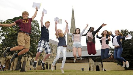 Students from Norwich School celebrate after collecting their GCSE results this morning. Pictured: L