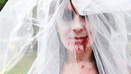 Undead fans dress-up and take part in a charity Zombie walk through Yarmouth.Danna Baytun.