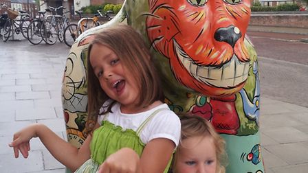 Lucy and Phoebe James, five and two, with Hattie the GoGoGorilla.Their baby sister, born on August 2