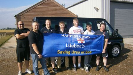 Happisburgh RNLI three peaks challengers at their lifeboat station
