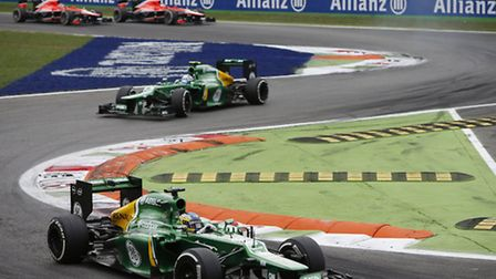 Caterham lead their two Marussia rivals during the Italian Grand Prix at Monza.