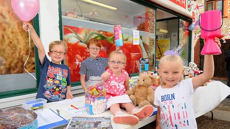 The Wright siblings, left, Ben, 7, Josh, 9, and right, Ellie, 5 at their cake stall and tombola at C