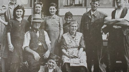 Louisa Prestney (fourth left) aged 12, pictured with her family in fron of the converted bus they ca
