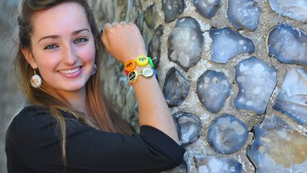 Notre Dame High School student Florence Ventham with her bottle top jewellery. Photo: Steve Adams