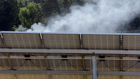 A solar panel substation on fire near Swaffham, with fire fighters attending the scene. Picture: Mat