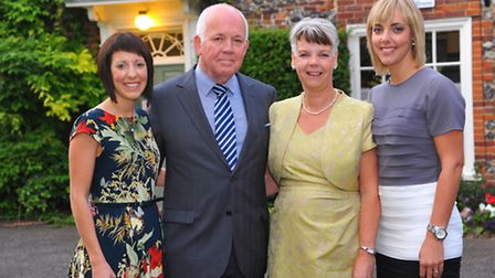 Retiring Senior Coroner for Norfolk William Armstrong with his wife Monica and daughters Amy, left a