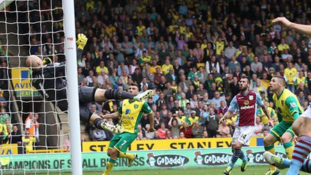 Brad Guzan acrobatically denies Gary Hooper in the closing stages of Norwich City's 1-0 Premier Leag