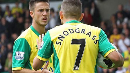 Robert Snodgrass pulls rank with Ricky van Wolfswinkel over the early penalty awarded against Aston Villa. Picture: Paul...