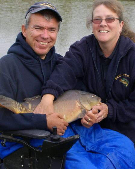 Rob Bunting, with a little help from… his wife Tina…, on his way to top weight on Yew Lake with this