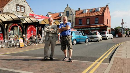 Sheringham pedestrian crossings. Left, Sheringham Chamber of Trade chairman Barry Starling and owner