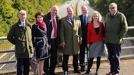 Transport minister, Stephen Hammond, centre, at the A47 yesterday <mon> with local MPs, from left, Henry Bellingham, Chloe...