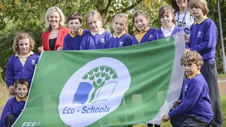 MP Liz Truss visits pupils at Shouldham Primary School and presenting them with a Eco Schools flag.