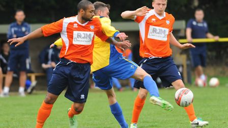 Norwich United V Diss. Jerome Trotter, left, and Thomas Dew for Diss, and Jamie George for Norwich U