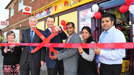 Local MP Peter Aldous officially opens the new post office with store manager Raj on Rigbourne Hill,